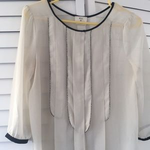 Ultra feminine cream blouse with black detail